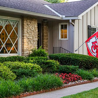 kc chiefs flag in front of senior care home