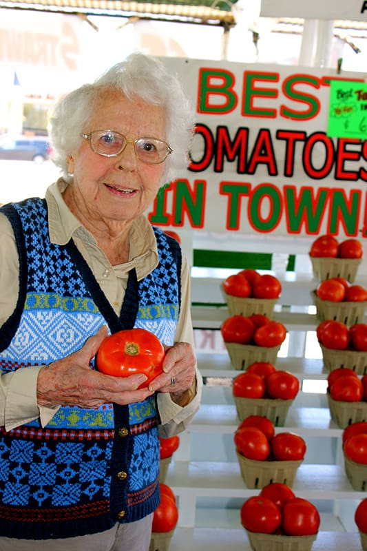 senior lady with tomato