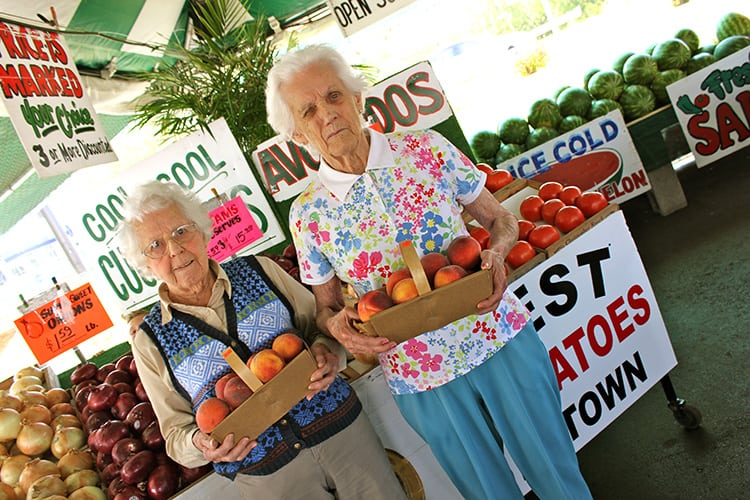 senior ladies fruit stand