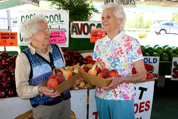 senior ladies at fruit stand