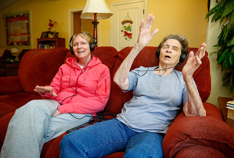 senior women listening to music